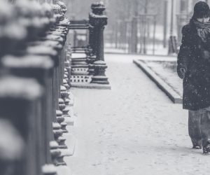 person walking on the street in snow
