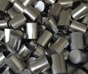 close up of a pile of tin cans without rappers