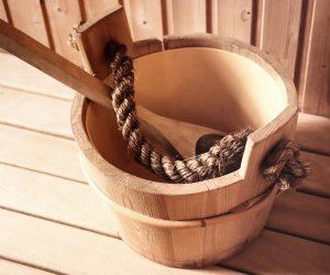 wooden spoon inside a wooden bucket