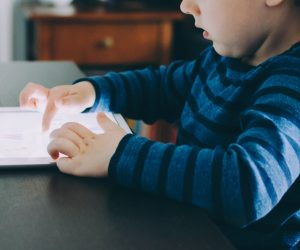 image of a child playing on an iPad