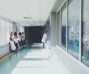 doctors standing in a hallway in a hospital
