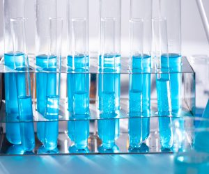 clear test tubes filled with blue liquid