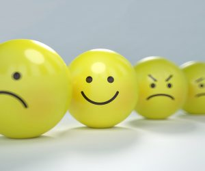 yellow faces with a frown, smile, mad and nervous