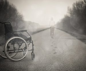 person walking away from a wheelchair