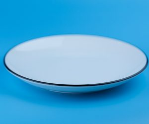 empty white plate on a blue background