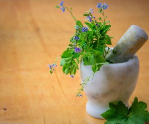mortar and pestle with herbs inside