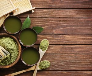 matcha tea in cups with matcha powder