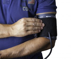 man taking his own blood pressure