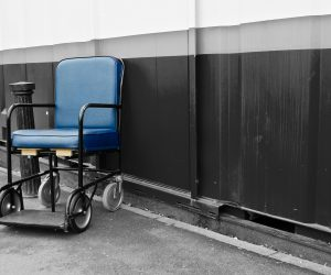empty electric wheelchair by a wall