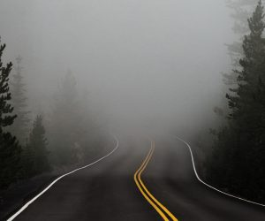 a road with fog in the distance