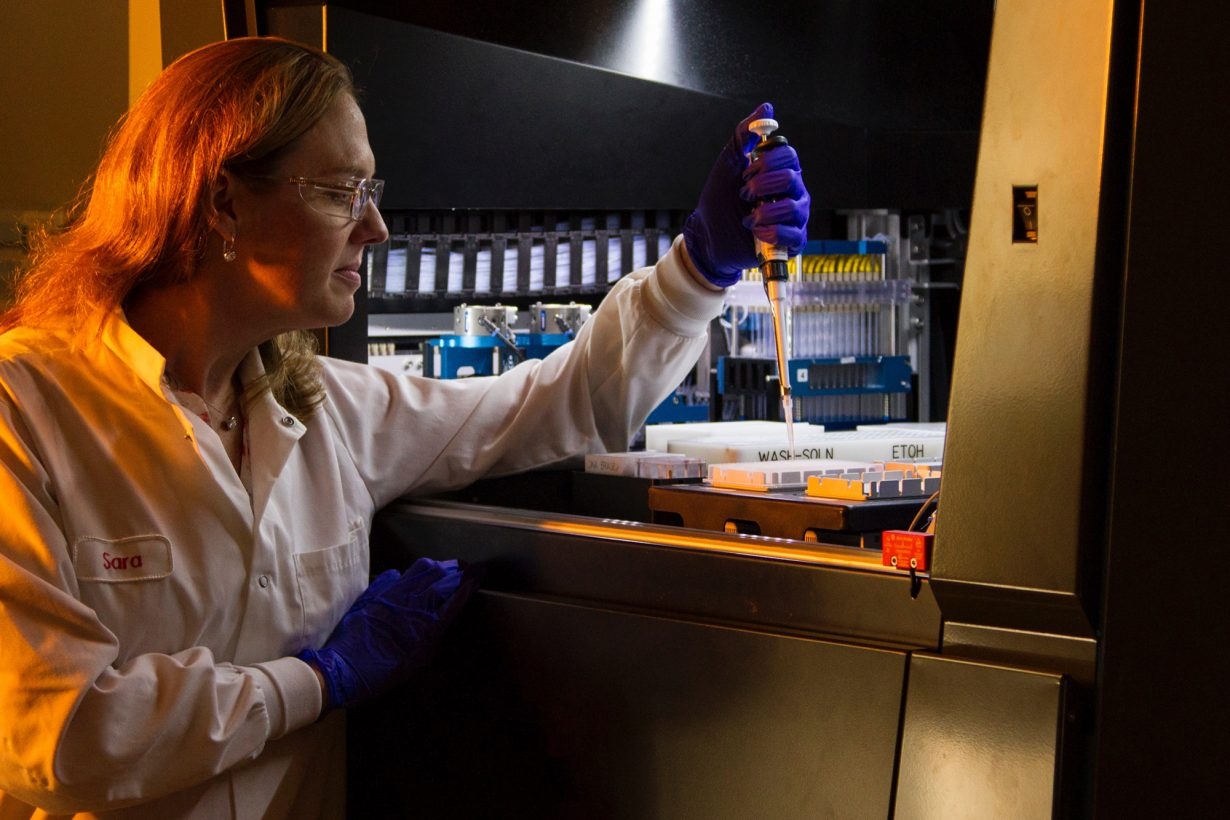 female lab researcher working in a lab