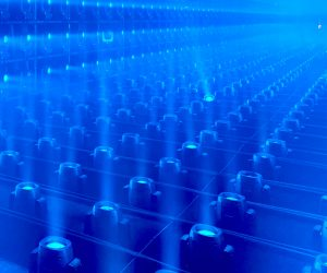 a bunch of blue lights lined up in a room