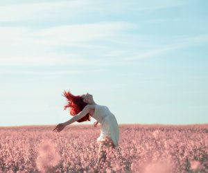 woman carefree in a field of flowers
