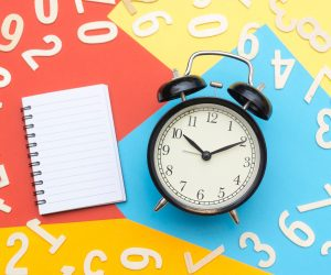 analog clock against a colorful background