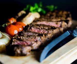sliced up steak on a cutting board