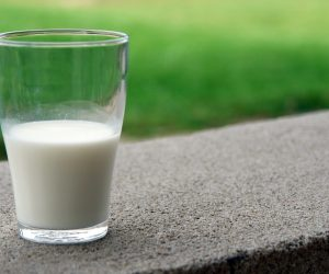 glass of milk on a concrete surface