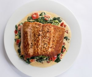 salmon fillet on a white plate