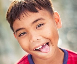 child sticking out their tongue