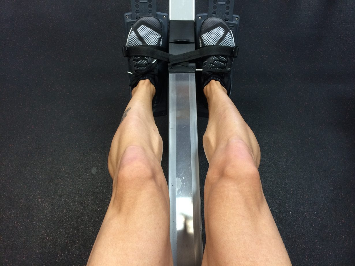 man's legs working out on a machine