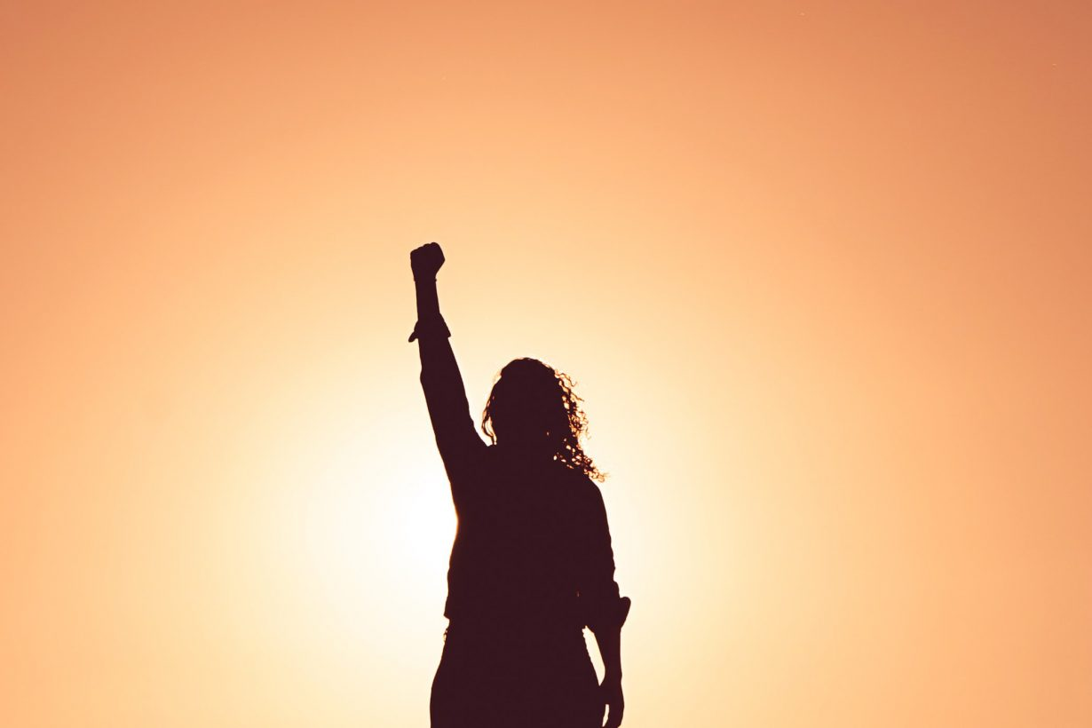 woman reaching up to the sky