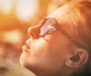 woman turning her face toward the sun