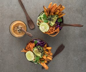 brown bowls full of vegetable salad