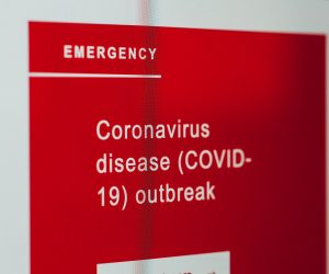 Coronavirus sign on a wall