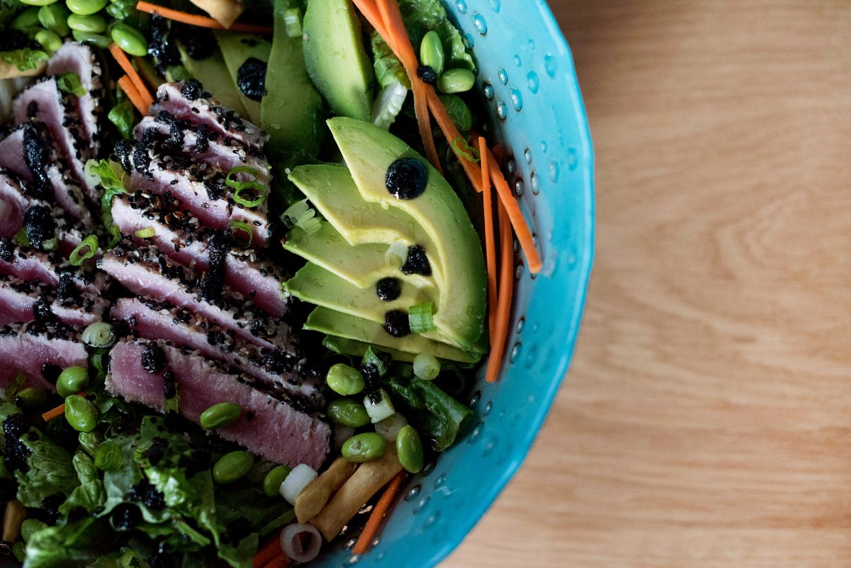 close up of a healthy salad in a blue bowl