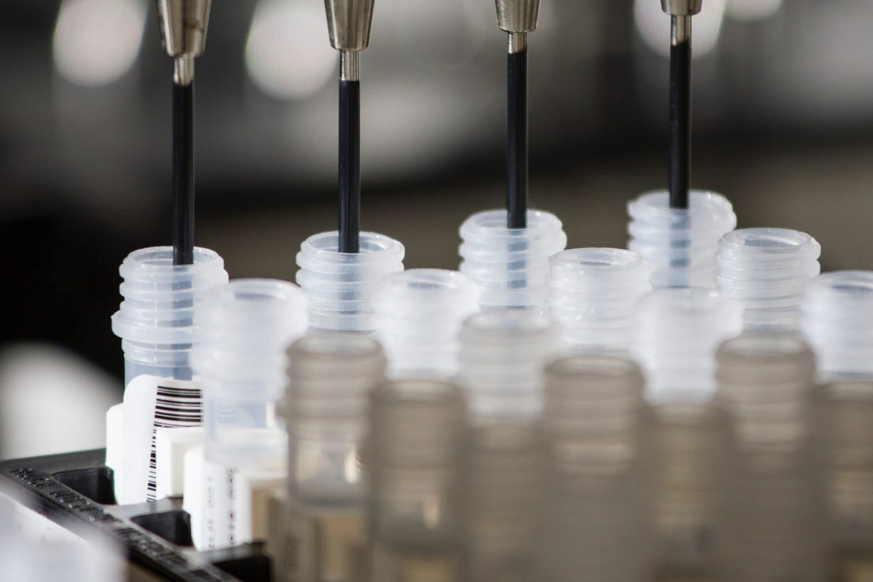 rows of test tubes being filled