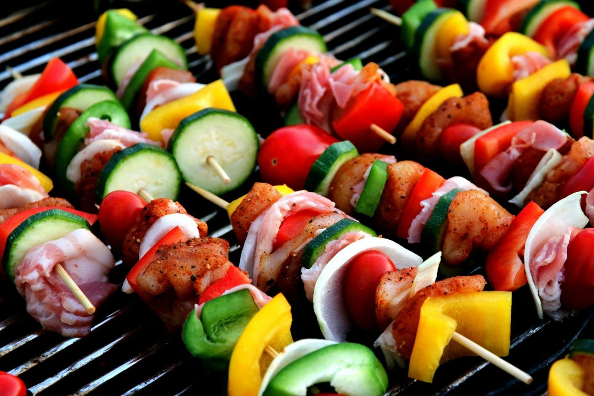 vegetables on skewers on a grill