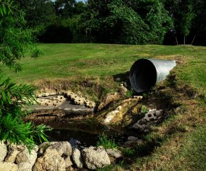 sewage pipes in grass