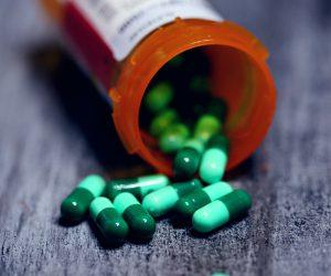 pill bottle of green pills