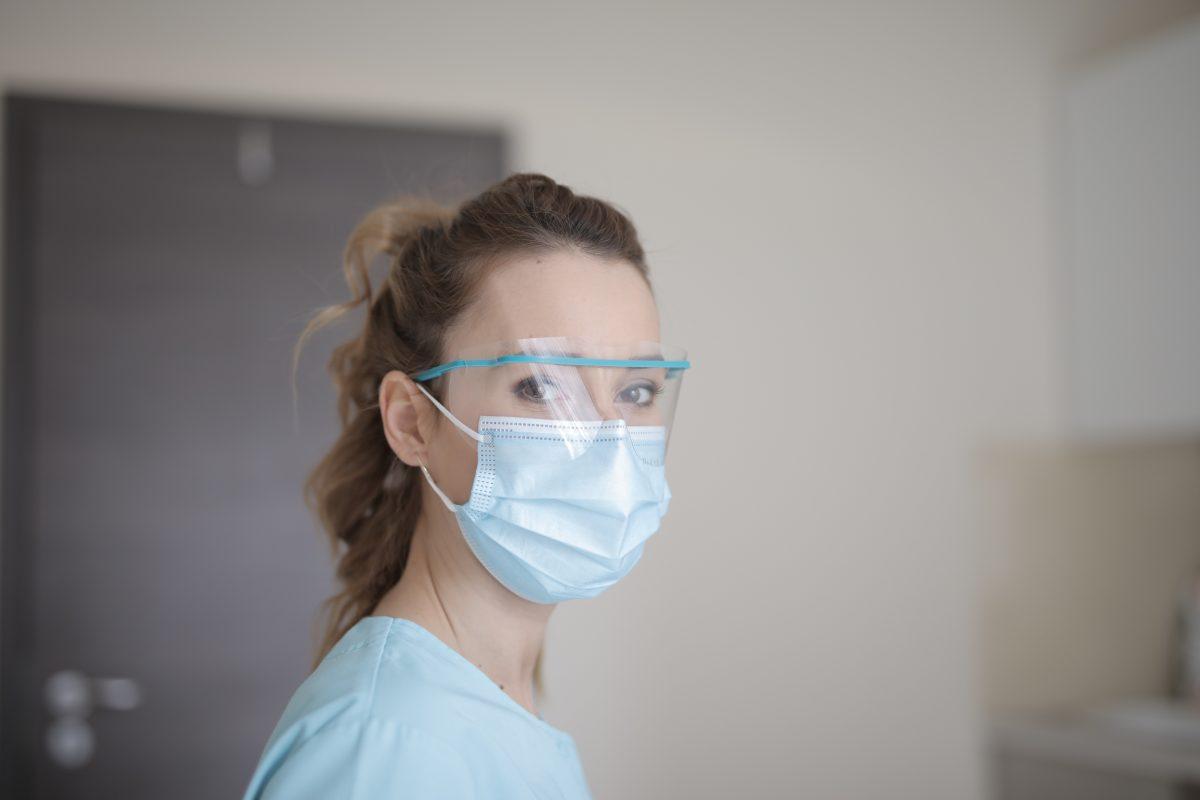woman wearing eye guard and mouth guard
