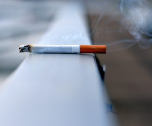 cigarette burning on a white surface