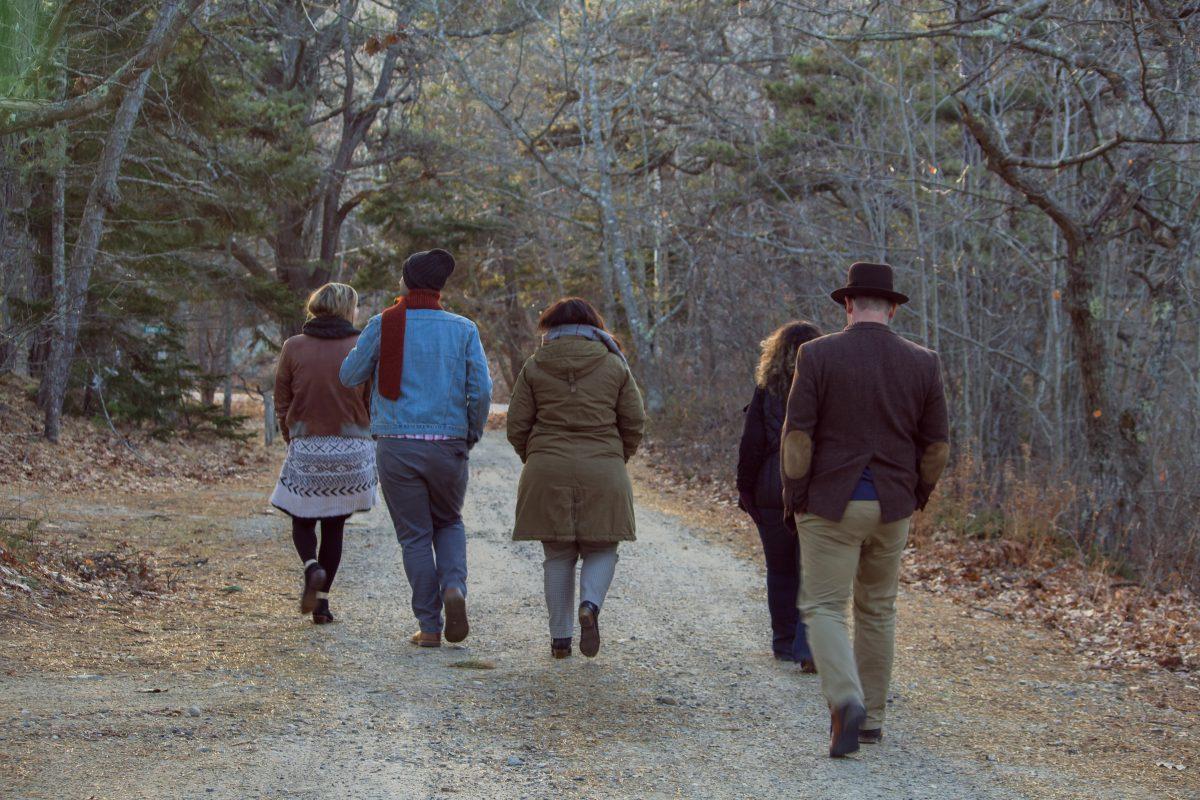 people walking outside in a group