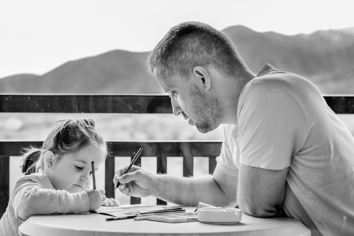 daughter and father coloring together