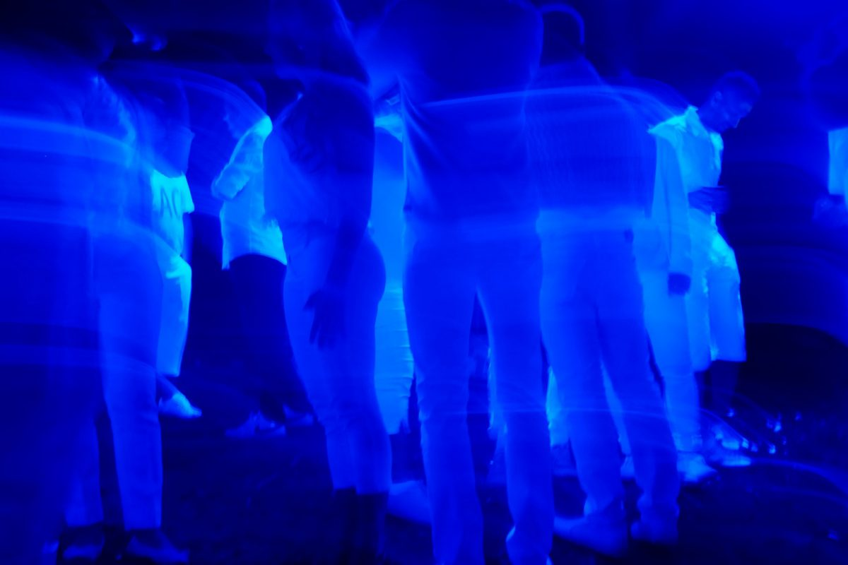 people standing in a blue light