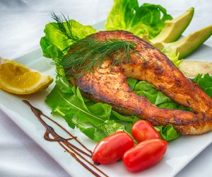 blackened salmon fillet on a white plate
