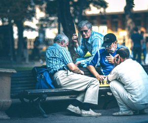 men playing chess at a park