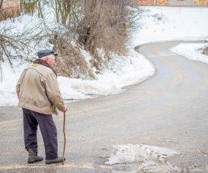 old man walking in the winter