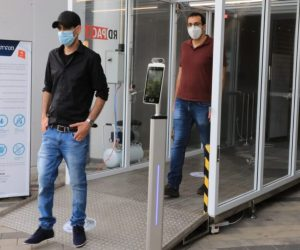 Dr. Eran Avraham, left, and Dr. Izaak Cohen from Bar-Ilan University walk through the sanitation tunnel at the entrance to Bloomfield Stadium in Tel Aviv.