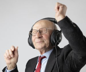 old man dancing with headphones one