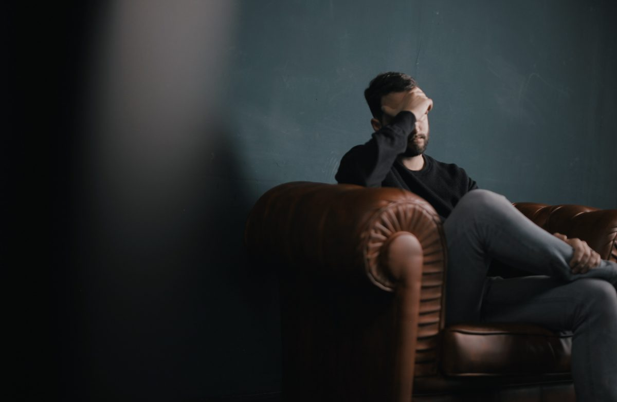 stressed out man on a couch