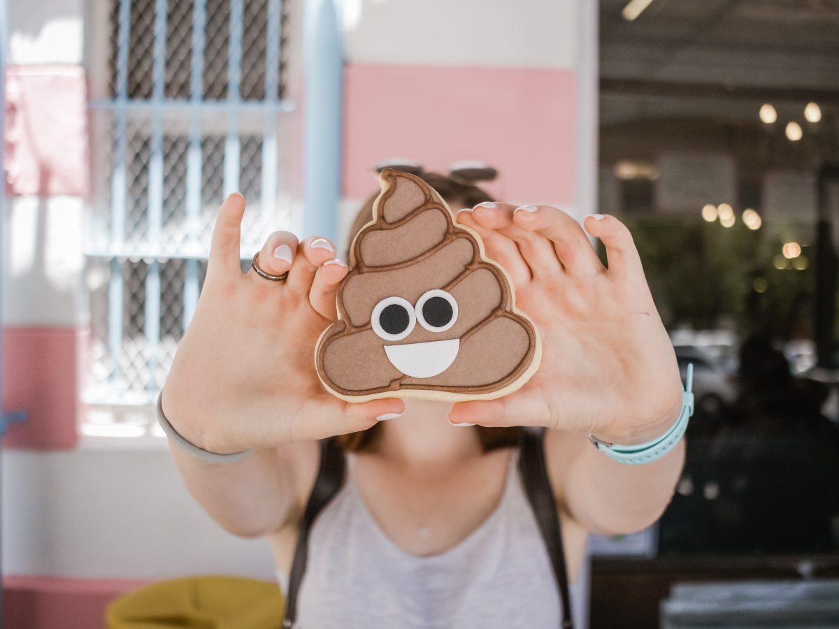 person holding the poop emoji