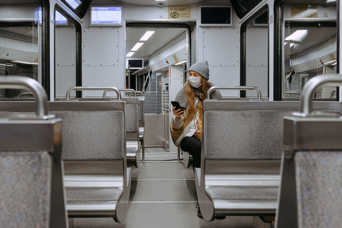 woman riding alone on a bus