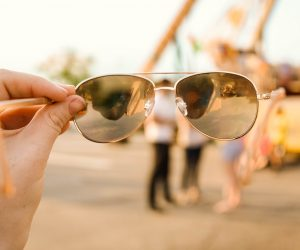 person holding up eye glasses