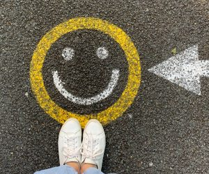 smiley face painted on asphalt