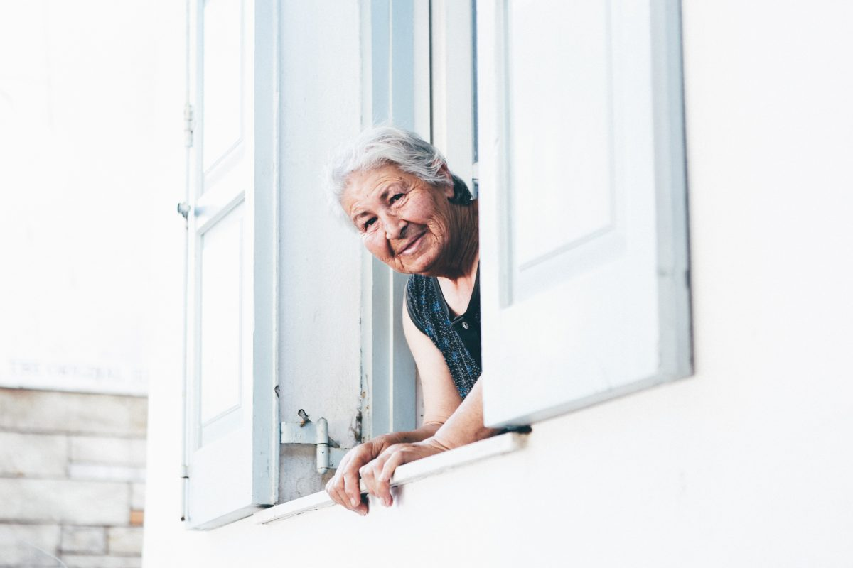 older woman looking out a window
