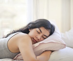 woman sleeping on a pillow