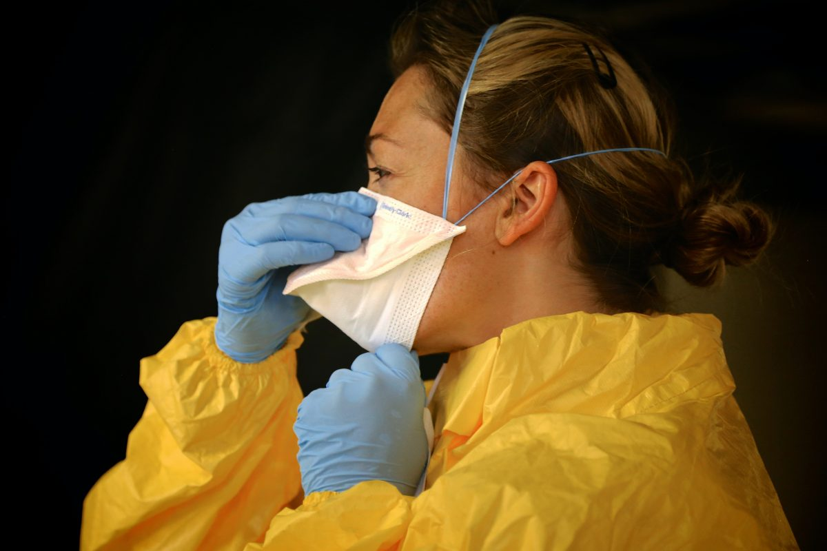 woman wearing yellow personal protective equipment